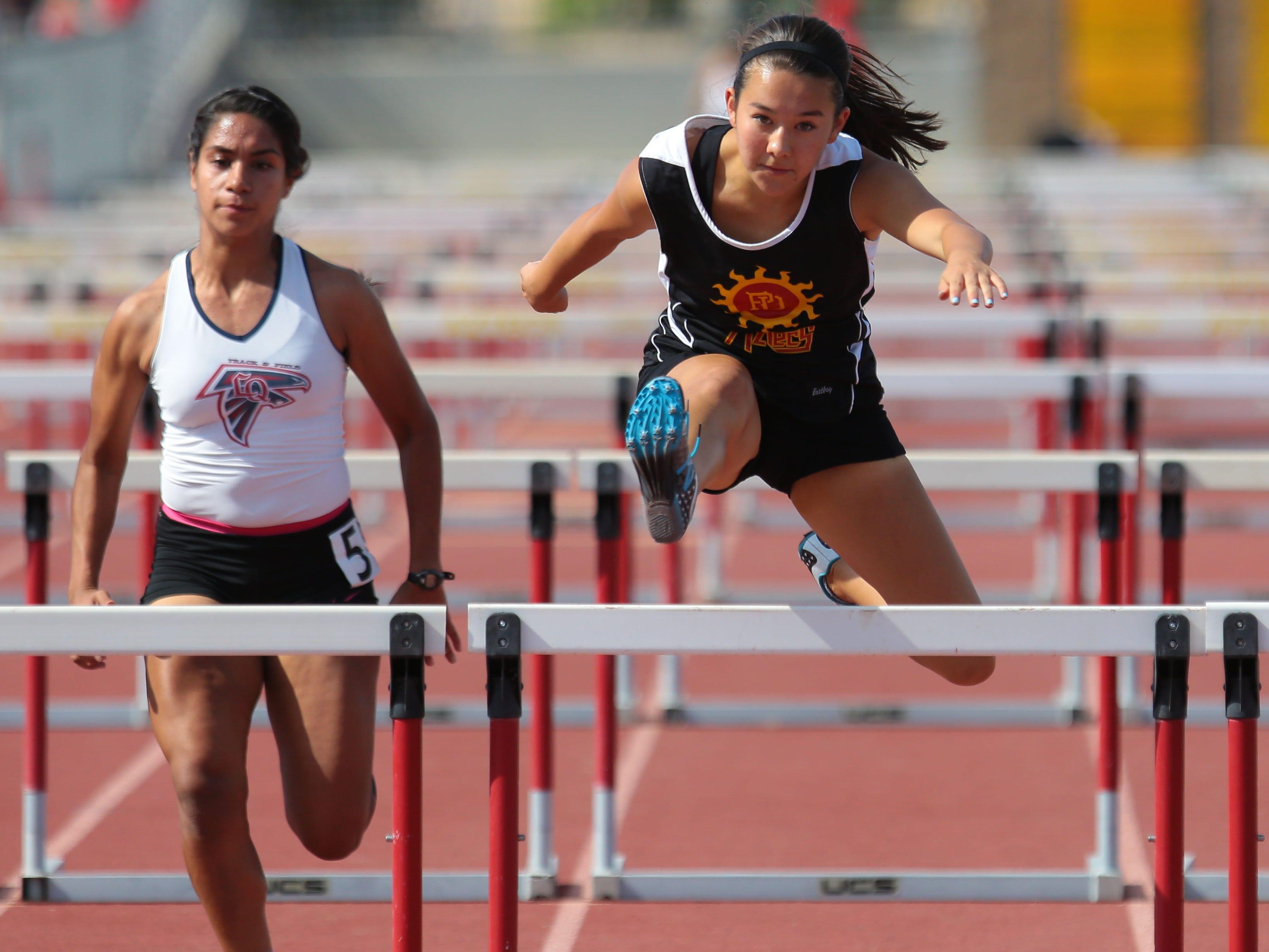 Palm Desert's Kira Leggat jumps her last hurdle for a first place finish in the 100 hurdles on Thursday in Palm Desert.