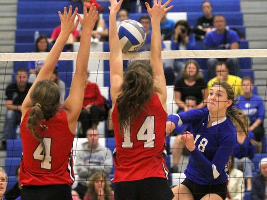 Rachel Aiello (left) and Shayna Webber of Baldwinsville try to block the hit by Megyan Merrill of Horseheads during the championship game of the Horseheads Classic.