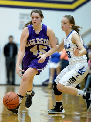Hagerstown's Savannah Houck moves the ball around Centerville's Merissa Ross during the 40th Annual Wayne County Basketball Tournament Thursday, Jan. 7, 2015, in Hagerstown.