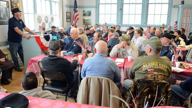 Danielson Veterans Coffeehouse President Fred Ruhlemann talks to attendees at the Killingly Community Center in February 2018. The group plans to have its first meeting since March on June 30 outdoors at St. John Lutheran Church in Danielson.