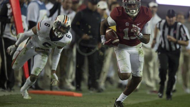 Alabama wide receiver ArDarius Stewart (13) scores a touchdown in the third quarter during the Iron Bowl in Tuscaloosa on Saturday, Nov. 26, 2016.