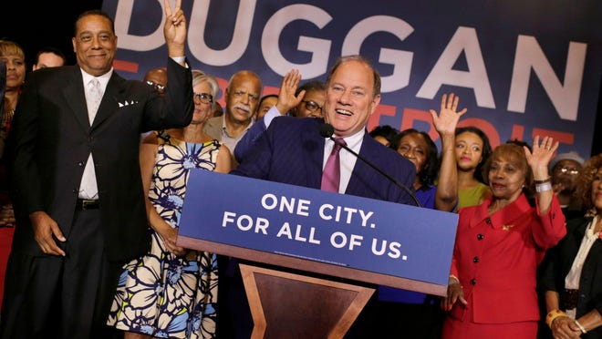 Detroit Mayor Mike Duggan talks to a crowd of supporters during the mayoral primary election night in Detroit in August.