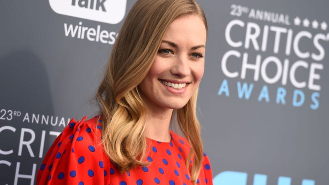 "Yvonne Strahovski shared that while filming ""The Handmaid's Tale"" people thought she had the flu before she revealed she was pregnant."