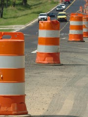 Traffic and orange barrels are shown in this file photo.