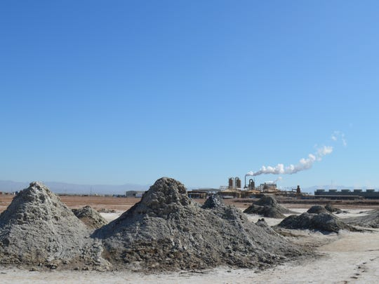 EnergySource's Featherstone geothermal plant by the Salton Sea belches steam on April 29, 2016, with mud pots in the foreground.
