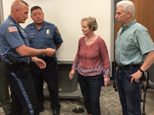 Wanaque Police Chief Robert Kronyak presents a World War I medal to Tom Luciani and Janice Sannick, the closest surviving family members of veteran Dan Battaglia. The medal, belonging to Battaglia, was found on the side of a road and turned in to police.