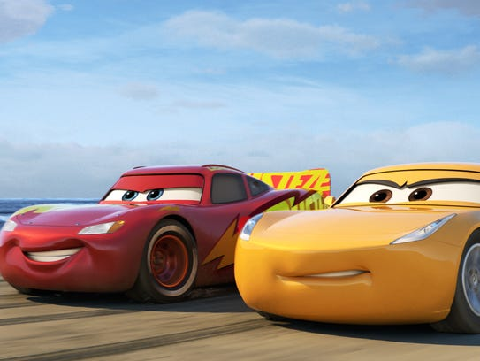 Lightning McQueen (left, voiced by Owen Wilson) hits