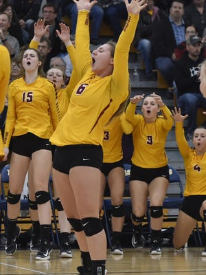 Annie Kinnard and the Luxemburg-Casco bench celebrate a point against Little Chute during a Division 2 sectional final in Chilton on Saturday.
