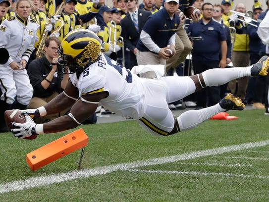 Michigan's Jabrill Peppers falls into the end zone