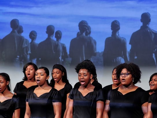 Stax Academy choir members perform during a ceremony