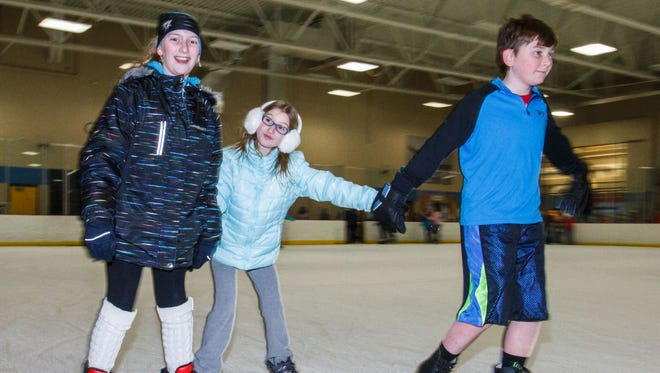 Members of the LaPorte family of Pewaukee (from left) Lydia, Dahlia and Noah public skating at Naga-Waukee Ice Arena last January.