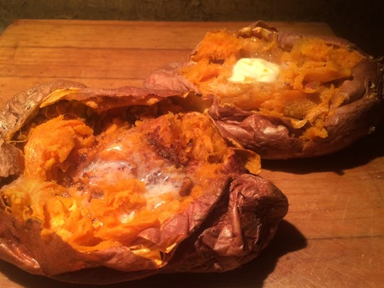Baked sweet potatoes with butter and brown sugar.