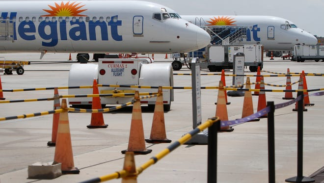 Allegiant Air jets await service and passengers on the tarmac at the Punta Gorda Airport Tuesday in Punta Gorda.