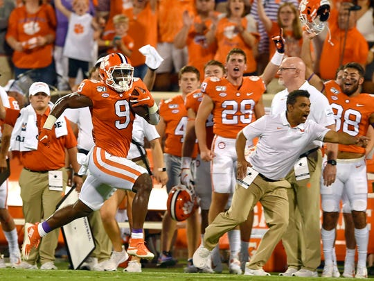 Clemson's Travis Etienne runs down the sideline for a 90-yard touchdown Aug. 29 during the first half of an NCAA college football game against Georgia Tech, in Clemson, S.C.