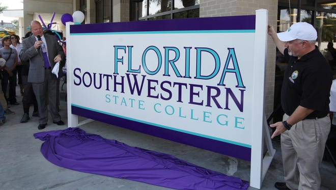 FSW President Jeff Allbriten and Florida Representative Matt Hudson participate in spirit days , a ceremonial unveiling of Edison State College's new name, on Tuesday at the Fort Myers campus.