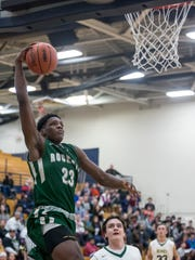 New Haven's Romeo Weems dunks the ball during a regional