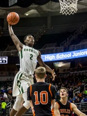 New Haven's Eric Williams Jr. dunks the ball during