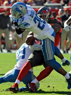 Detroit Lions cornerback Quandre Diggs forces Tampa Bay Buccaneers tight end O.J. Howard to fumble in the first half Sunday, Dec. 10, 2017 in Tampa, Fla.