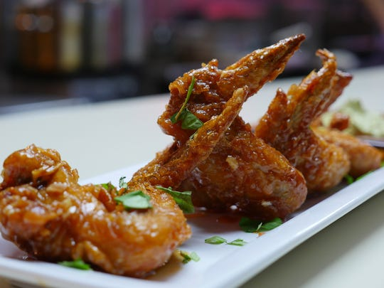 Korean-fried caramel chicken wings are one of the few non-Vietnamese dishes on the menu at the Flowers of Vietnam pop-up inside Vernor Coney Island in Southwest Detroit on Sunday, March 13, 2016.