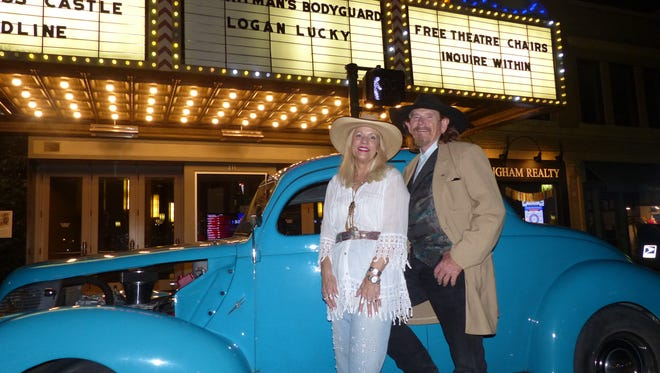 """James """"Catfish"""" Chapman Jr. and """"Miss Ellie"""" Haley of Fredericksburg, TX stop by Birmingham in his 1938 5 Window """"Parrotsbeak"""" Ford in turquoise blue. This is Catfish's 13th Woodward Dream Cruise and Miss Ellie's second."""