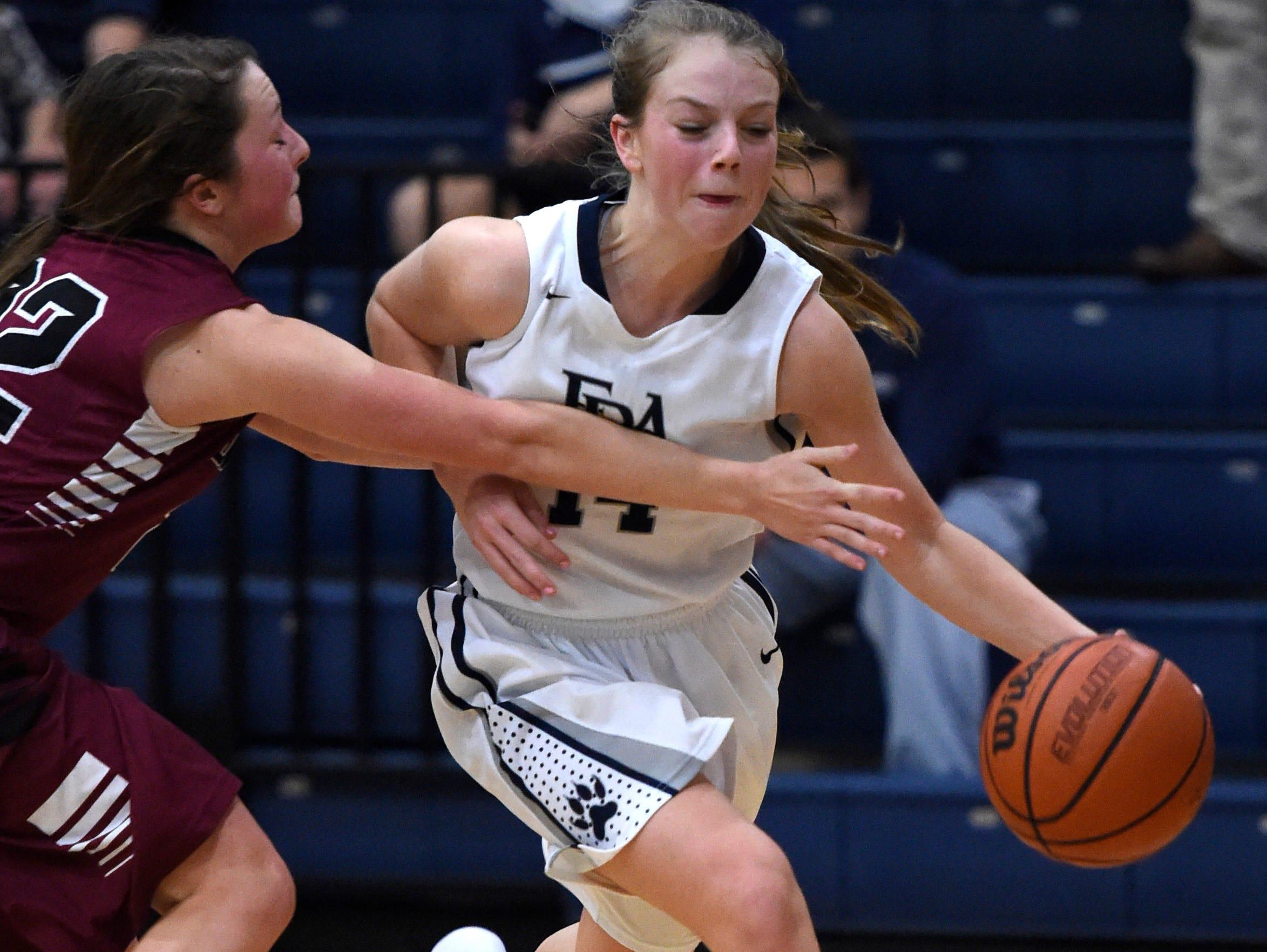Davidson Academy's Davis Smith (22) fouls FRA's Taylor Casey as she drives to the basket on Jan. 8, 2016.