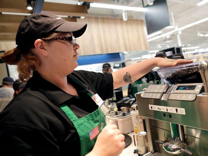 Regina Murray trains Starbucks employees inside the