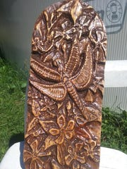 Dragonfly wood carving by Tina Brodeck, part of the