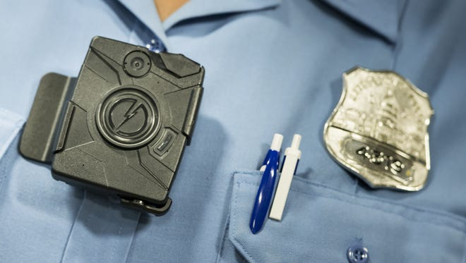 A body camera from Taser is seen during a press conference at City Hall September 24, 2014 in Washington, DC. The Washington, DC Metropolitan Police Department is embarking on a six- month pilot program where 250 body cameras will be used by officers.