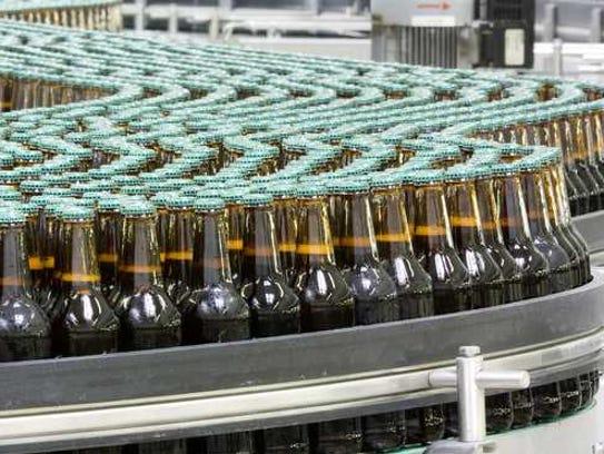 Bottled beverages on a conveyor belt.