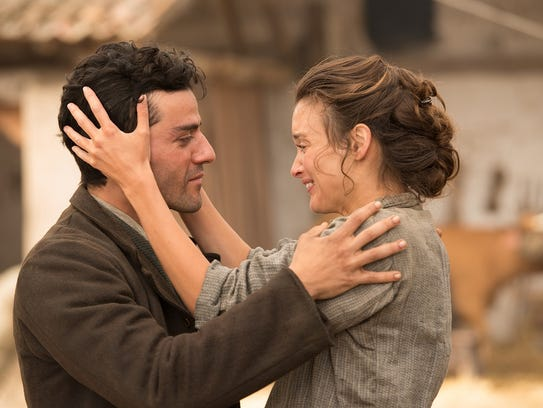 Oscar Isaac and Charlotte Le Bon in a scene from 'The