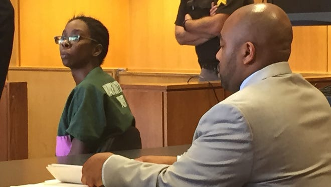 Tiffanie Edwards, 29, left appears with her lawyer, Kareem Johnson, in 36th District Court for a preliminary examination on Wednesday, Sept. 16.