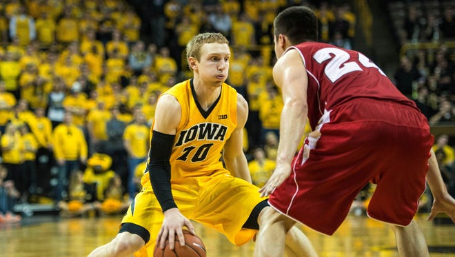 Iowa guard Mike Gesell (10) is defended by Wisconsin guard Bronson Koenig (24) during the second half at Carver-Hawkeye Arena last season.