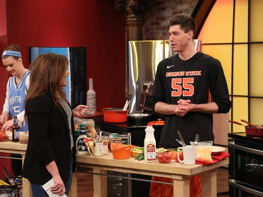 OSU sophomore Todd Williams explains his dish to Rachael Ray.