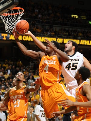 Tennessee forward Armani Moore (4) rebounds a shot by Missouri forward Keanau Post (45) in the second half Saturday.