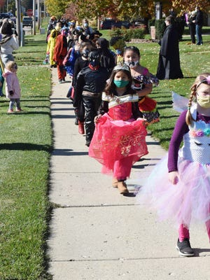 Most of the masks they were wearing weren't part of their costumes, but the Visitation Catholic School students and faculty had their annual Halloween parade Friday afternoon. The parade has been a tradition at the school since the early 1970s.