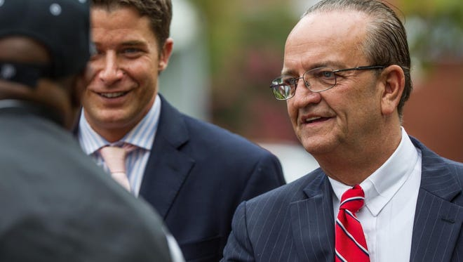 David Grimaldi (left), then-chief administrative officer of New Castle County,  and County Executive Thomas P. Gordon are shown at an event in Wilmington. A recorded phone call between them was released Tuesday, highlighting political maneuvering regarding a county employee's spouse who serves in the General Assembly.