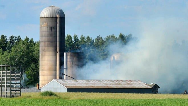 A barn destroyed by fire Tuesday afternoon in Weston.
