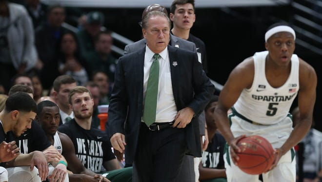 Michigan State coach Tom Izzo on the bench, watching Cassius Winston pass, during the first half of MSU's 88-81 loss on Tuesday, Nov. 14, 2017, in Chicago.