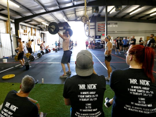 """CrossFitters wear shirts for """"Mr. Nick"""" during a memorial"""
