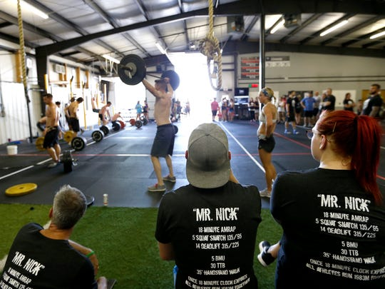 "CrossFitters wear shirts for ""Mr. Nick"" during a memorial"