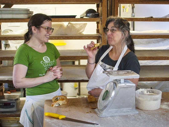 Sophie Conway, left, and her mother Carla Kevorkian sample a new pastry recipe at O Bread Bakery at Shelburne Farms.