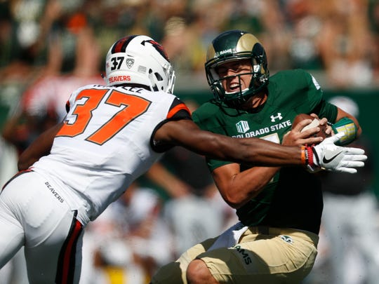 Oregon State Beavers linebacker Kee Whetzel (37) stops Colorado State Rams quarterback Nick Stevens (7) in the second half of an NCAA college football game Saturday, Aug. 26, 2017, in Fort Collins, Colo.