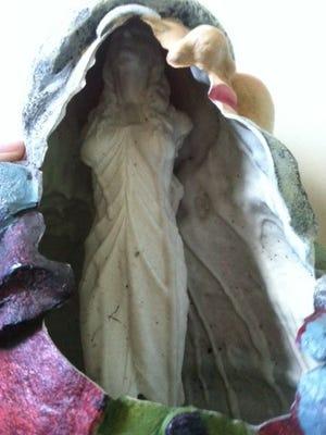 Heather Andrews of Pulaski, Tenn., was surprised to see a strange statue inside her broken garden gnome.