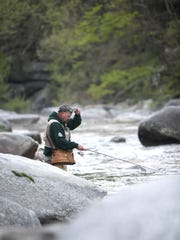 Fishermen line the Rocky Broad River in Bat Cave. The N.C. Wildlife Resources Commission stocks fish on about 1000 miles of hatchery-supported trout waters in 25 counties for the season.