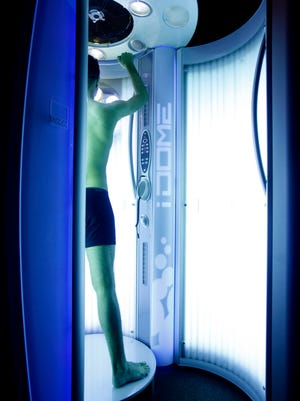 Tanning booths, like the sun outdoors, increase the risk of skin cancer.