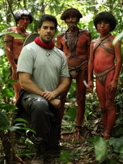 """Eli Roth and local villagers on the Peruvian set of """"The Green Inferno."""""""