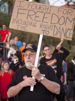 St. George residents dance in front of the St. George City Hall to protest laws regarding dancing Thursday, Nov. 6, 2014.