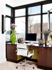 The built-in desk in the kitchen has fabulous views of the water and historic Fells Point. The paint color under the desk is Forest Moss by Benjamin Moore. The desk chair is the Antonio from Nuevo (nuevoliving.com ). MUST CREDIT: Photo by Jennifer Hughes for The Washington Post.