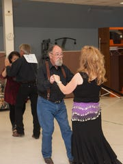 J.D. Shoop and Judy Justus share the floor with Juliet Dean and Mark Warren  dancing the Cha Cha.