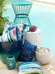 Make your patio memorable with colorful throw pillows,